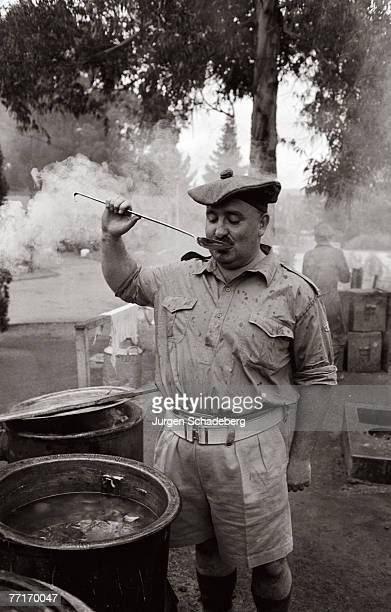 The sergeant major of a South African Scottish Regiment tastes the company's stew circa 1955