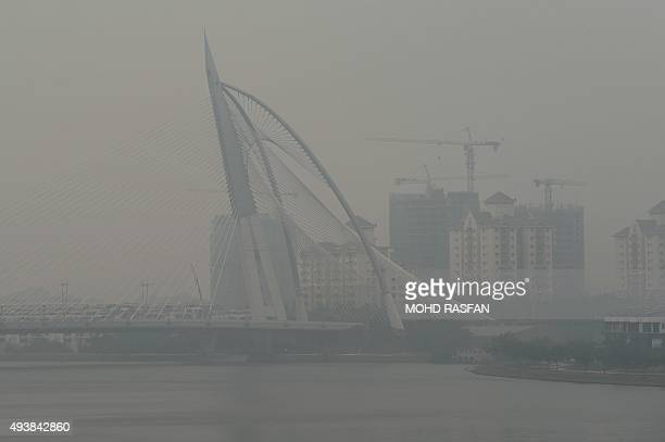The Seri Wawasan bridge is seen covered by haze in Putrajaya on October 23 2015 Fires raging across huge areas of Indonesia are spewing more...