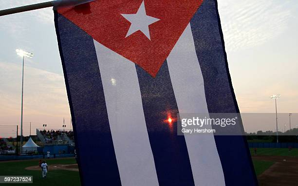 The seting sun is seen through a Cuba flag during their Toronto 2015 Pan Am Games baseball game against the USA in Ajax Ontario July 12 2015