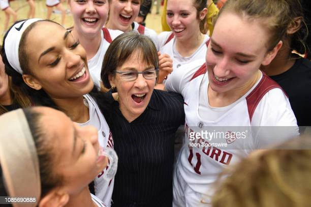 The Setsuko Ishiyama Director of Womens Basketball Tara Vanderveer who notched her 900th win at Stanford celebrates with her players including...