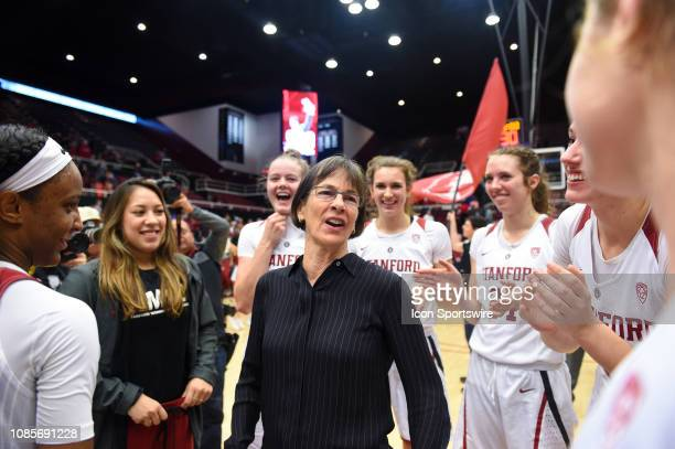 The Setsuko Ishiyama Director of Womens Basketball Tara Vanderveer who notched her 900th win at Stanford celebrates with her players after the...