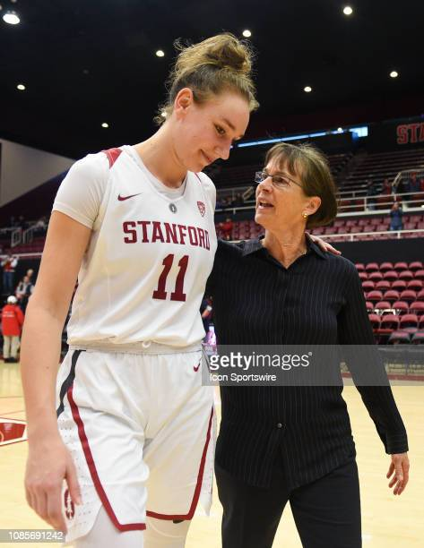 The Setsuko Ishiyama Director of Womens Basketball Tara Vanderveer, who notched her 900th win at Stanford, hugs Stanford Forward Alanna Smith , who...