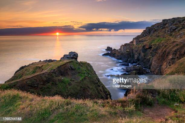 The setting sun captured from the clifftop above De Narrow Zawn at Botallack.