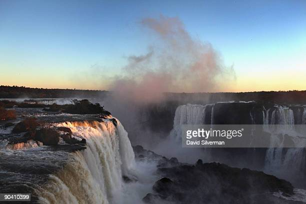 The setting sun casts its last light on the Iguacu Falls as seen from the Iguacu National Park on August 12 2009 near the town of Foz do Iguacu in...