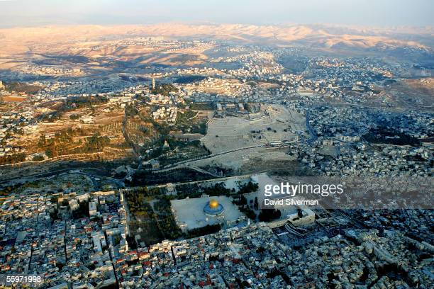 The setting sun casts its last rays over the golden Dome of the Rock Islamic shrine and alAqsa Mosque on the Temple Mount October 20 2005 in this...
