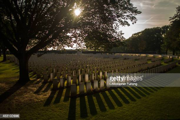 The setting sun creates long shadows in front of the graves at Sanctuary Wood Military Cemetery on August 1 2014 in Ypres Belgium Monday 4th August...