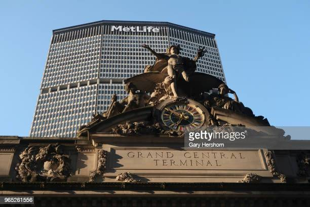 The setting sun hits a statue on the top of Grand Central Terminal in front of the MetLife Building on May 29, 2018 in New York City.