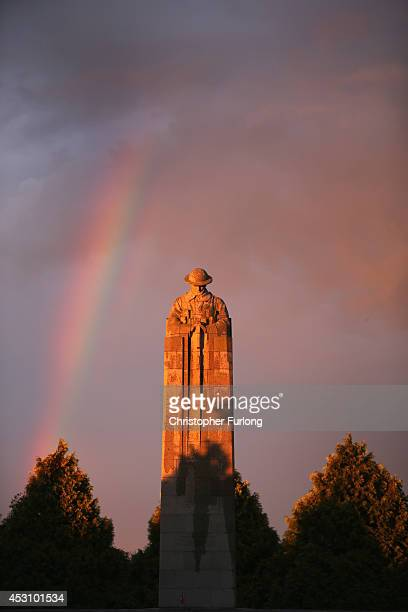 The setting sun illuminates the sculpture of the 'Brooding Soldier' and creates a rainbow The monument commemorates the Canadian First Division's...