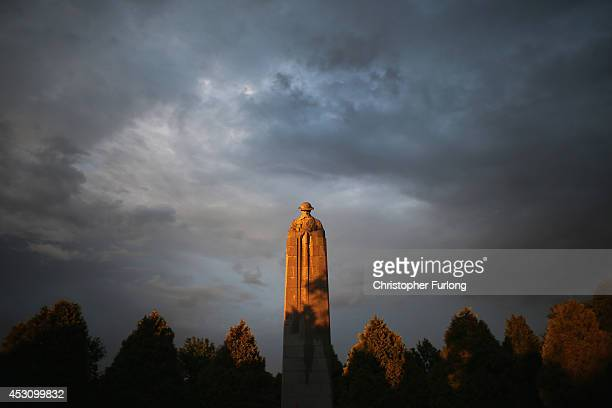 The setting sun illuminates the sculpture of the 'Brooding Soldier' the monument commemorates the Canadian First Division's participation in the...