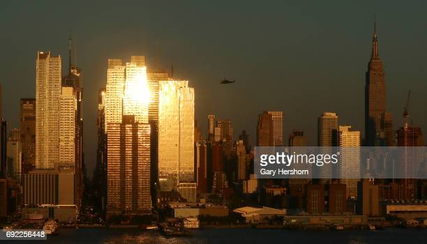 The setting sun reflects off of buildings in New York City on June 2 as seen from Weehawken NJ