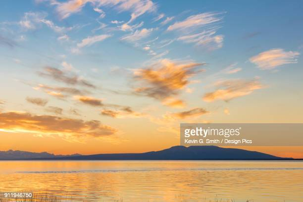 the setting sun silhouettes mount susitna, seen from earthquake park, south-central alaska - mt. susitna stock pictures, royalty-free photos & images