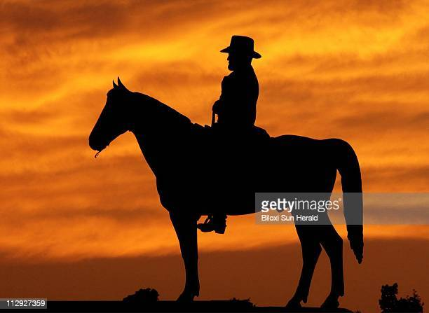 The setting sun silhouettes the statue of Union general Ulysses S Grant at the Vicksburg National Military Park as illustrated from one of Tim...