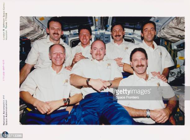 The seven crew members of Space Shuttle Discovery mission STS-103 pose for the traditional inflight crew portrait, 20th-28th December 1999. STS-103...