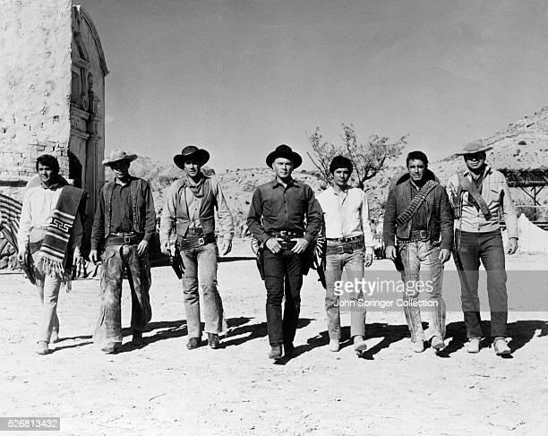 The seven gunfighters are from left to right Julian Mateos Virgilio Teixeira Robert Fuller Yul Brynner Jordan Christopher Warren Oates and Claude...