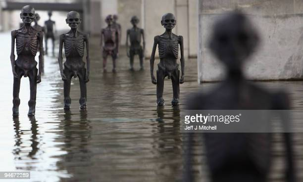 The seven meters crew bronze statues by sculptor Jens Galschiot stand outside the Bella Centre where the Cop 15 climate summit is taking place on...