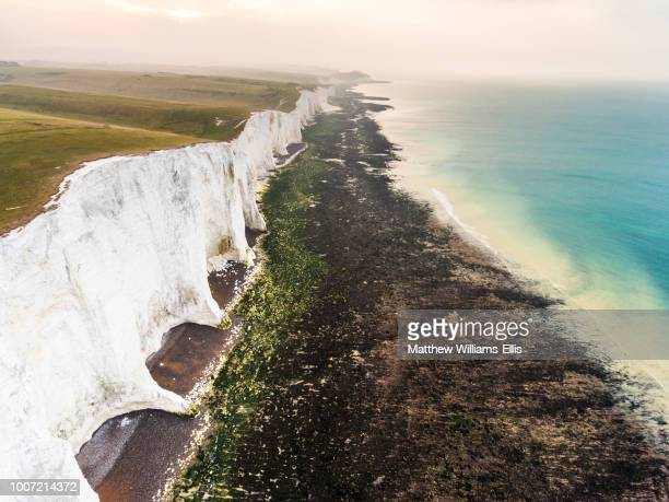 the seven sisters chalk cliffs, south downs national park, east sussex, england, united kingdom, europe (drone) - 炭酸石灰 ストックフォトと画像