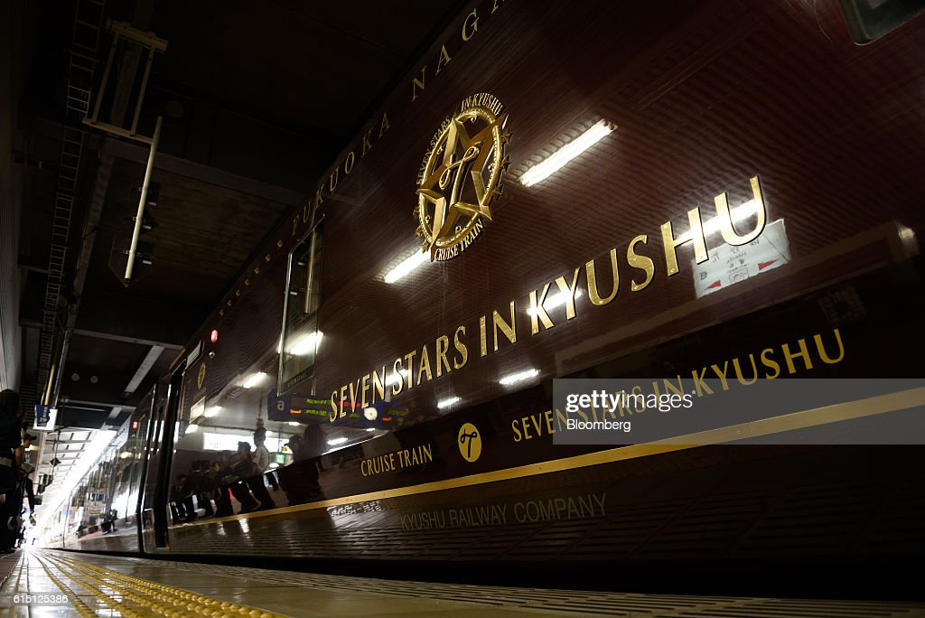 The Seven Stars in Kyushu luxury train, operated by Kyushu Railway Co., stops at Hakata Station in Fukuoka, Fukuoka Prefecture, Japan, on Tuesday, Oct. 11, 2016. JR Kyushu, the state-owned bullet-train operator seeking to raise as much as 416 billion yen ($4 billion) in an initial public offering, plans to reduce its reliance on Japan by investing in residential and office properties in Southeast Asia, its chairman said in an interview. Photographer: Akio Kon/Bloomberg via Getty Images