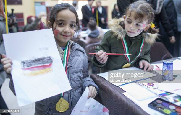 The seven year old Amal drew a German flag for German president FrankWalter Steinmeier as he visits the ArabicGerman AlQuds School in Amaan Jordan 28...