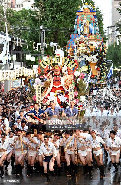 The seventh float 'Daikoku Nagare' rushes through Seido Street of Kushida Jinja Shrine during the Hakata Gion Yamakasa festival on July 15 2016 in...
