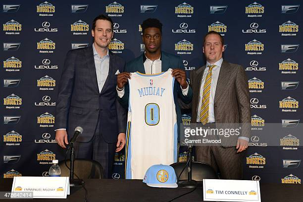 The seventh selection in the 2015 NBA Draft Emmanuel Mudiay of the Denver Nuggets poses for a photo with Team President Josh Kroenke and General...