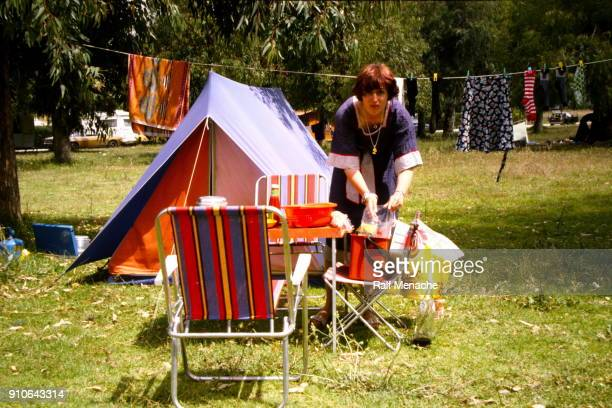 the seventies. a young woman enroute at a camping place. - 1974 stock pictures, royalty-free photos & images