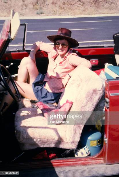 the seventies. a young woman enroute on the streets of turkey with a red beetle convertible for vacation. - 1970s stock photos and pictures