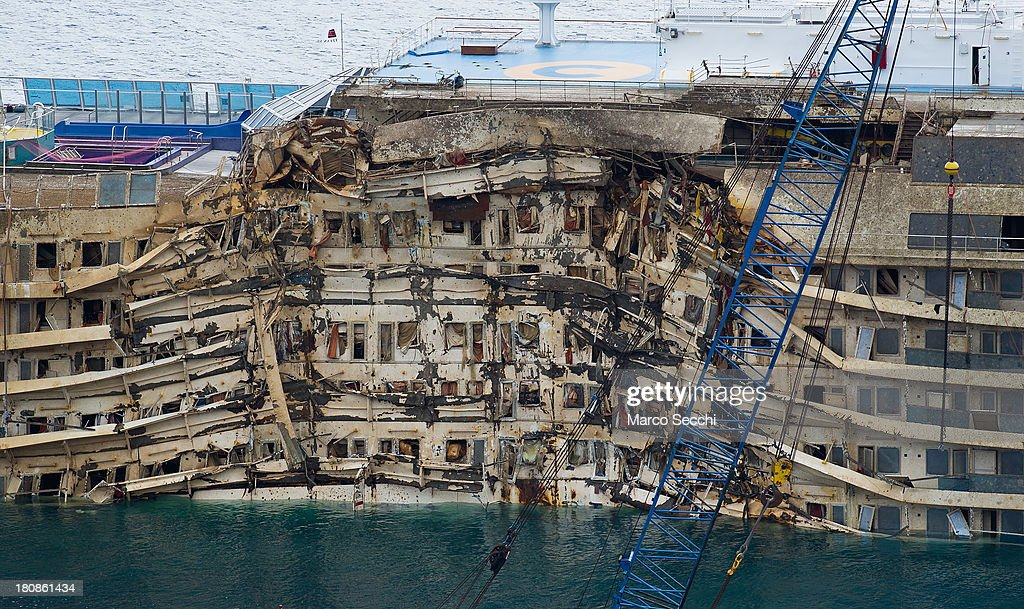 The severely damaged side of the stricken Costa Concordia is visible after the parbuckling operation succesfully uprighted the ship around 4 am on September 17, 2013 in Isola del Giglio, Italy. Work began yesterday to right the stricken Costa Concordia vessel, which sank on January 12, 2012. If the operation is successful, it will then be towed away and scrapped. The procedure, known as parbuckling, has never been carried out on a vessel as large as Costa Concordia before.