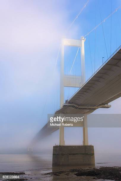 The Severn Bridge, in fog, spanning the Severn estuary and river Wye between Wales and England