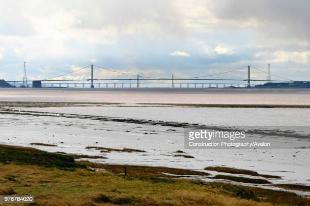 The Severn Bridge spans the Severn estuary a mile wide stretch of water proposed for the Severn Barrage for hydro power electricty near the Severn...
