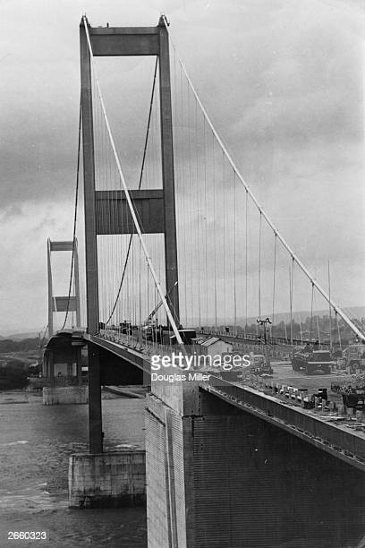 The Severn Bridge under construction seen from the Bristol side of the river