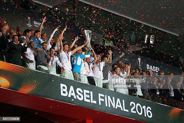 The Sevilla players celebrate with the trophy at the end of the UEFA Europa League Final between Liverpool and Sevilla at St JakobPark on May 18 2016...