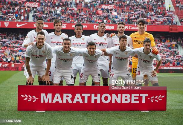 The Sevilla team line up for a photo prior to kick off during the Liga match between Sevilla FC and CA Osasuna at Estadio Ramon Sanchez Pizjuan on...