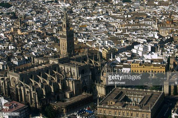 The Seville Cathedral and its bell tower La Giralda dominate the Seville skyline At lower right is the Archivo General de Indias