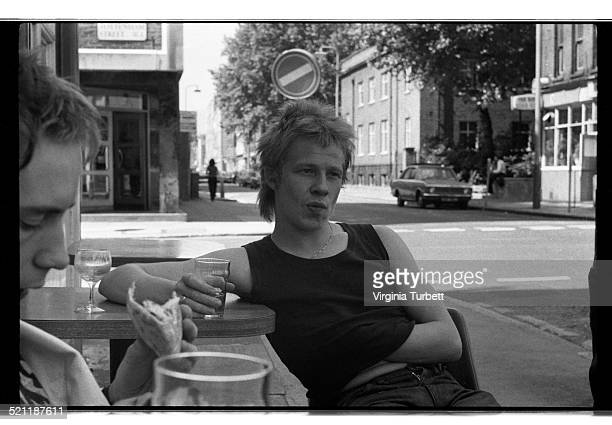 The Sex Pistols sit outside a pub during a break from recording a video for the song 'Pretty Vacant' London June 1977 LR Johnny Rotten and Paul Cook