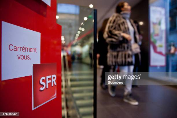 The SFR logo sits on display inside a mobile phone store operated by Vivendi SA in Paris France on Wednesday March 5 2014 Vivendi Europe's largest...