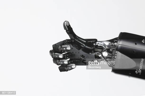 The Shadow Dexterous robotic hand manufactured by The Shadow Robot Company delivers a 'Thumbs Up' motion a gesture indicating approval during a...
