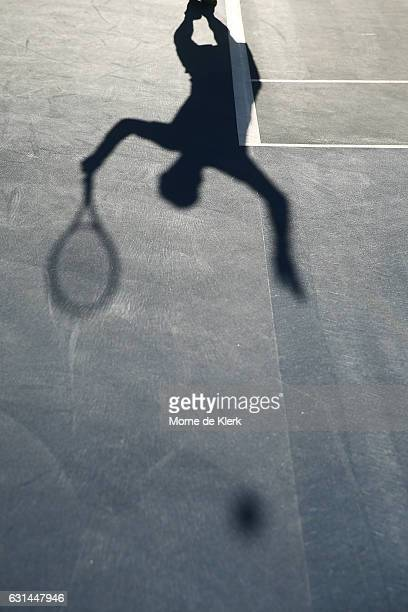 The shadow Mike Bryan of the USA is visible as he serves during the 2017 World Tennis Challenge at Memorial Drive on January 11 2017 in Adelaide...