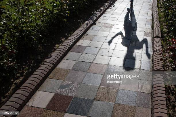 The shadow of a girl skipping is cast on a pavement in Dushanbe Tajikistan on Saturday April 21 2018 Flung into independence after the Soviet Union...