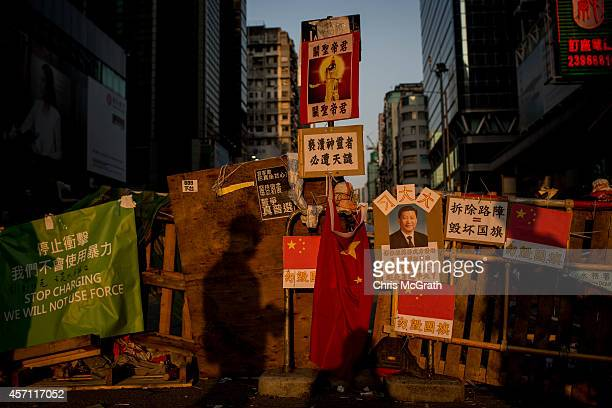 The shadow of a man is seen as he passes by a barricade placed on the street by prodemocracy activists at Mong Kok on October 12 2014 in Hong Kong...