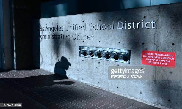 The shadow of a passing pedestrian is seen at the Los Angeles Unified School District headquarters in Los Angeles, California on January 9, 2019. -...