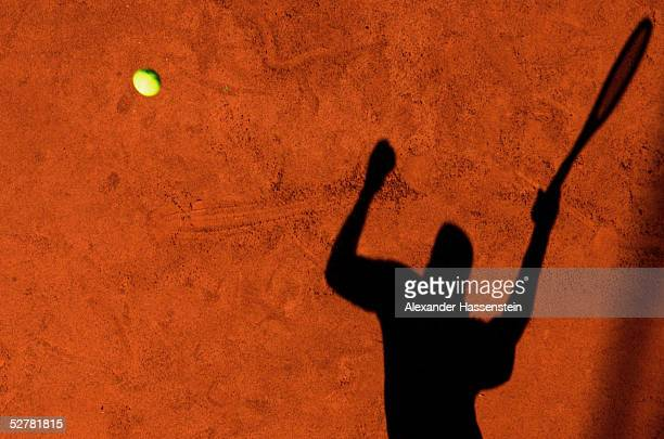 The shadow of a player stretches across the court during the Masters Series Hamburg at Rothenbaum on May 10 2005 in Hamburg Germany