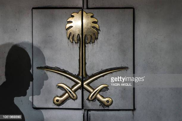 TOPSHOT The shadow of a security guard is seen on the entrance door of the Saudi Arabia's consulate in Istanbul on October 12 2018 A Saudi delegation...