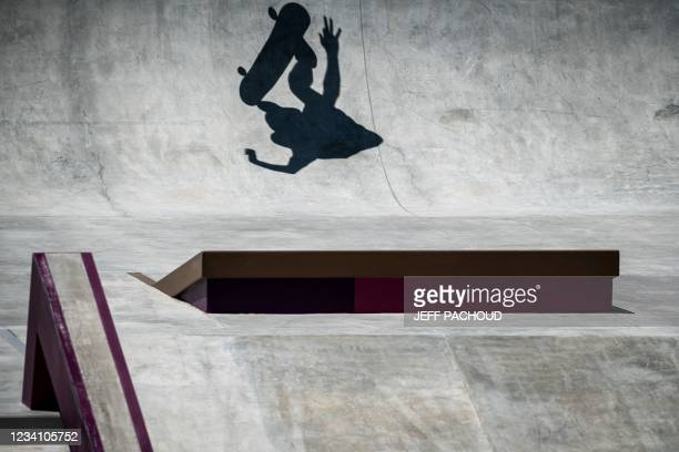 The shadow of a skateboarder is seen during a practice session at Ariake Urban Sports Park ahead of the Tokyo 2020 Olympic Games in Tokyo, on July...