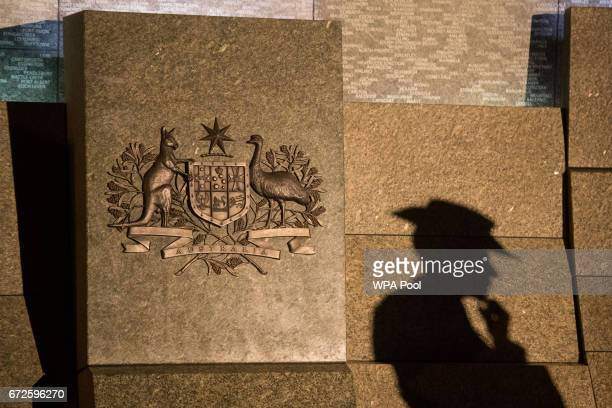 The shadow of a soldier falls on the Australian War Memorial during an Anzac Day dawn service at the Australian War Memorial at Hyde Park Corner on...