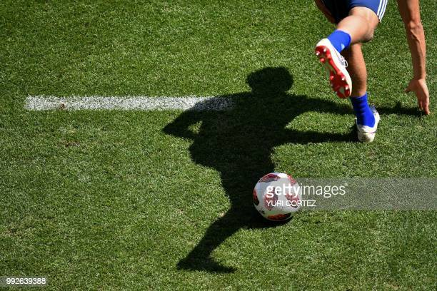 The shadow of a Sweden's player is cast on the grass during a training session on the eve of the Russia 2018 FIFA World Cup quarter final football...