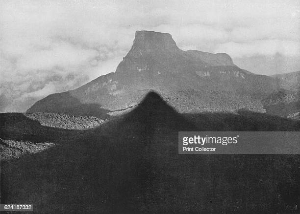 The Shadow of Adam's Peak and Bible Rock Taken from the Peak at Sunrise' c1890 From The Hundred Best Views of Ceylon [Plâté Ltd Colombo Kandy Nuwara...