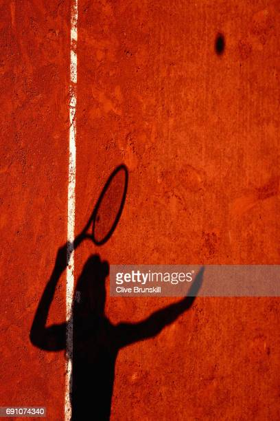 The shadow of Agnieszka Radwanska of Poland is pictured during her ladies singles second round match against Alsion Van Uytvanck of Belgium on day...