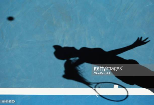 The shadow of Alize Cornet of France is seen in her third round match against Daniela Hantuchova of Slovakia during day five of the 2009 Australian...