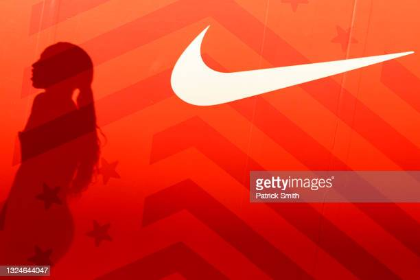The shadow of Allyson Felix is seen next to a Nike logo after finishing second place in the Women's 400 Meters Final on day three of the 2020 U.S....