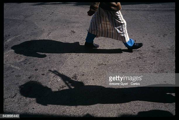 The shadow of an army soldier with the Algerian armed forces patrolling the streets of Algiers is projected on the sidewalk during the political...